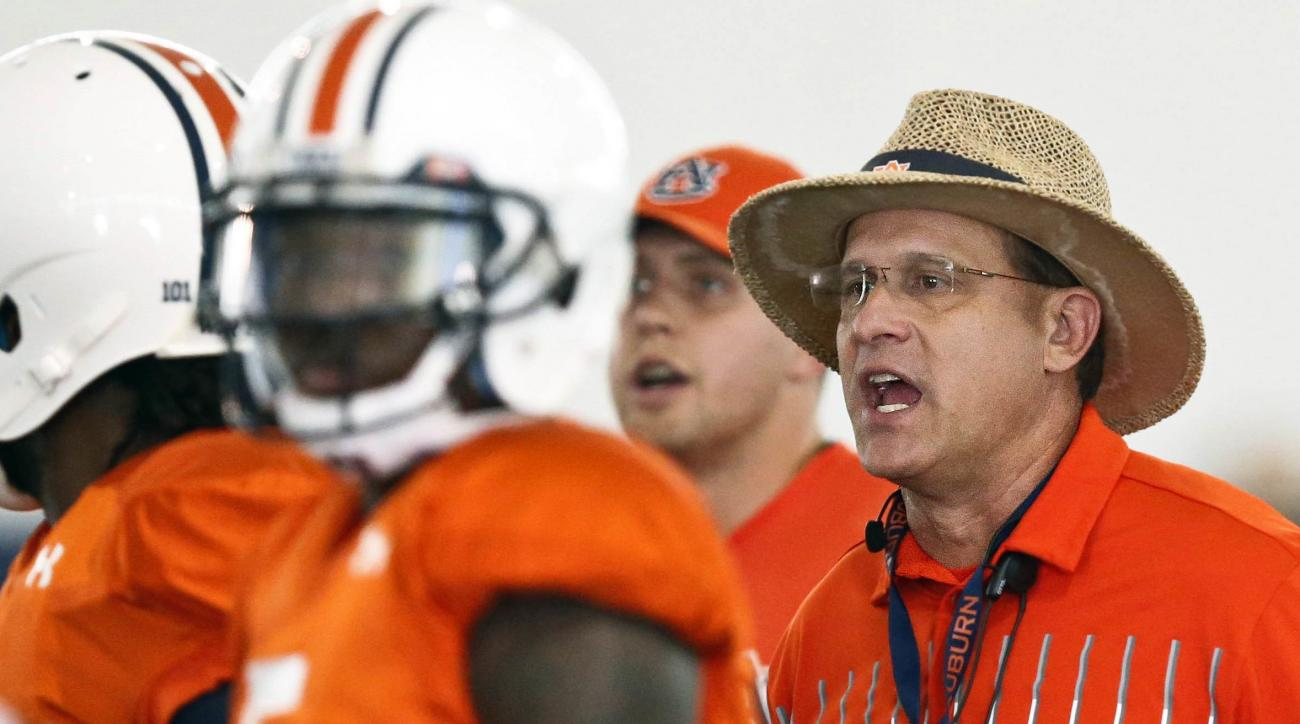 FILE - In this Aug. 6, 2016, file photo, Auburn coach Gus Malzahn yells towards offensive linemen running drills during an NCAA college football practice, in Auburn, Ala. Recent history suggests several teams will spend the first couple of weeks sorting o