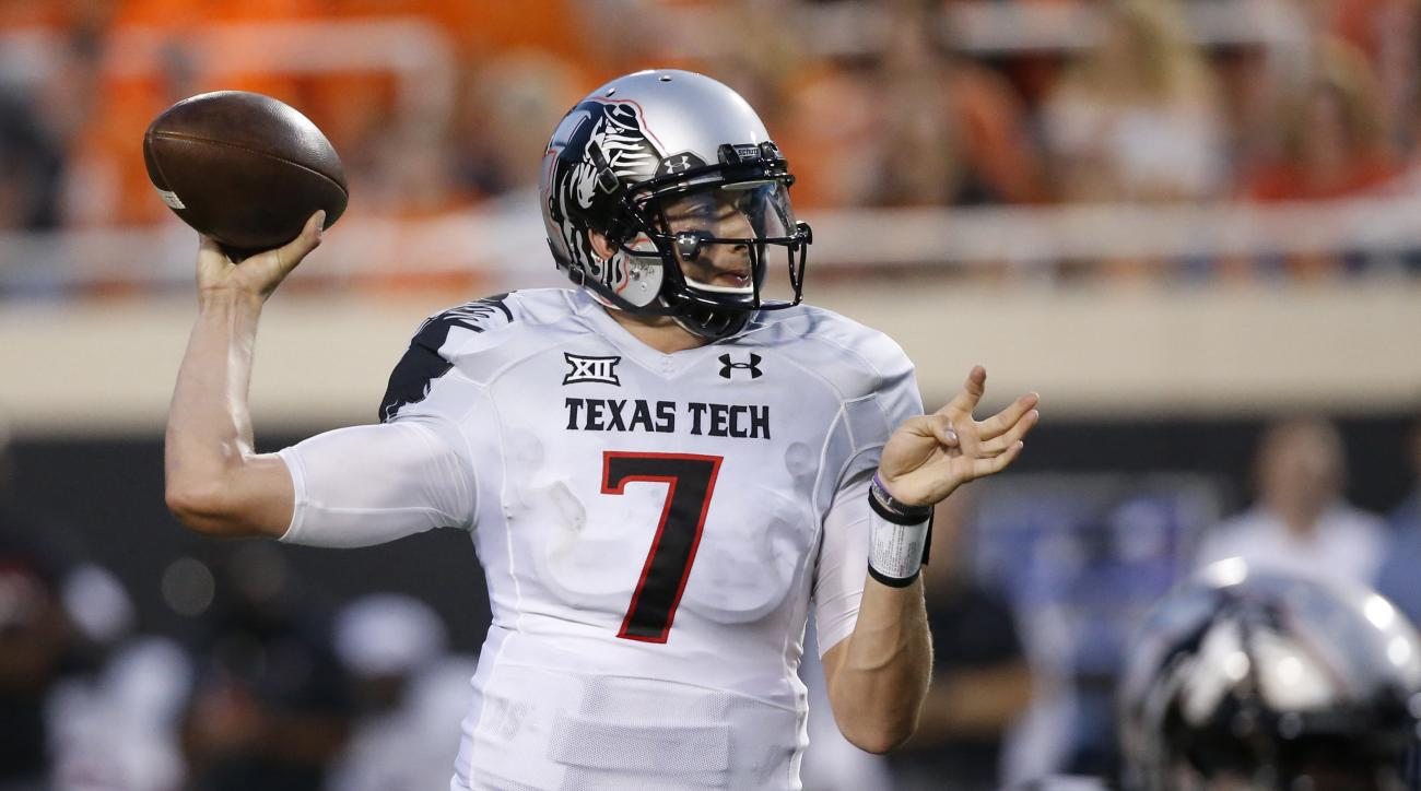 FILE - In this Sept. 25, 2014, file photo, former Texas Tech quarterback Davis Webb prepares to throw during an NCAA college football game against Oklahoma State in Stillwater, Okla. Webb, a graduate transfer, has been named the starting quarterback for C