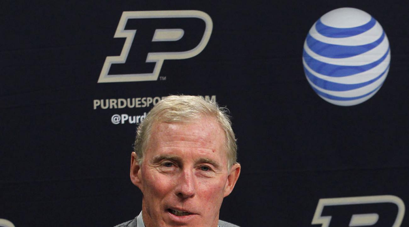 FILE - In this Nov. 25, 2012, file photo, Purdue athletic director Morgan Burke speaks during a news conference in West Lafayette, Ind. Burke has less than a year left in his tenure. And with his replacement, Mike Bobinski, already hired and expected to b