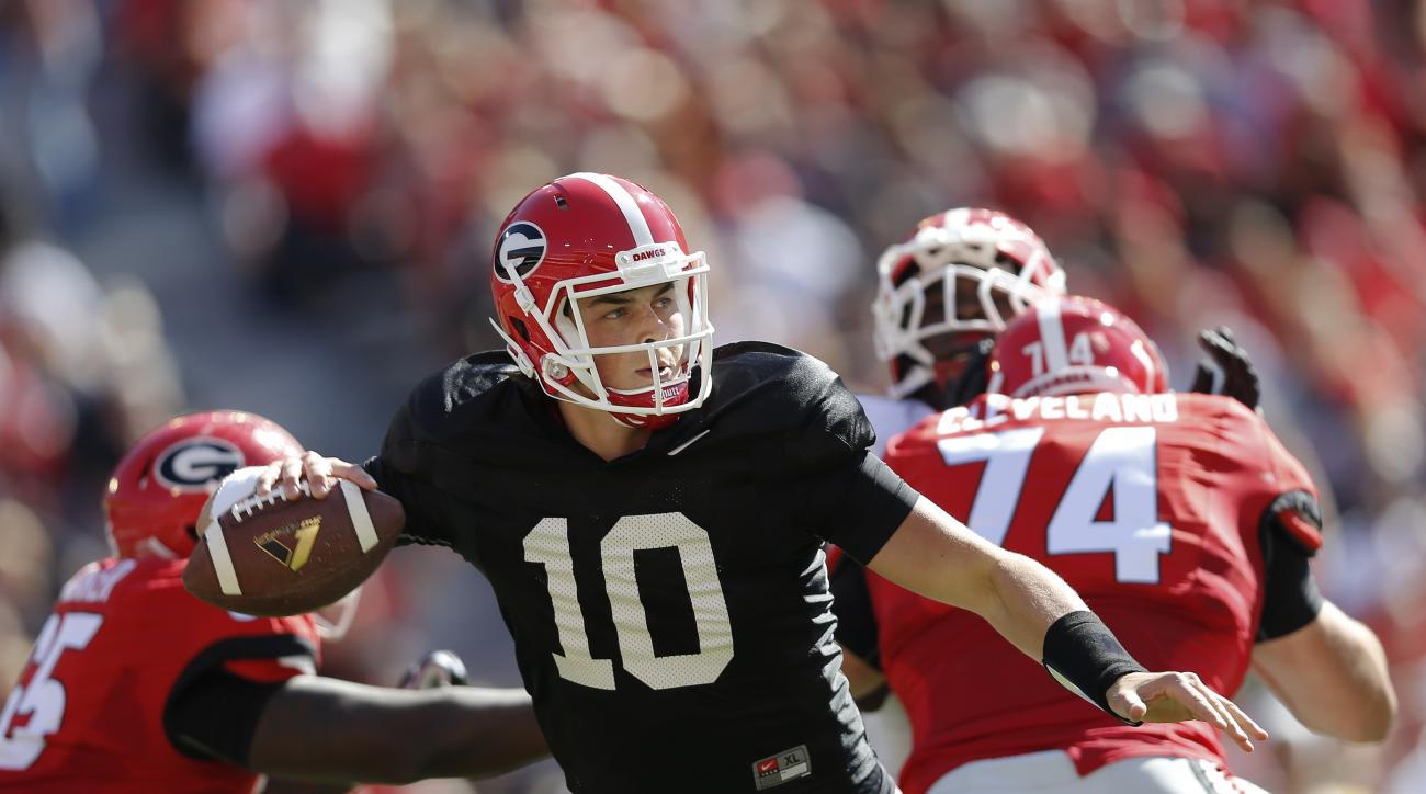 FILE - In this April 16, 2016, file photo, Georgia quarterback Jacob Eason throws during the first half of their spring intrasquad NCAA college football game, in Athens, Ga. Georgia coach Kirby Smart could be close to narrow the quarterback competition to