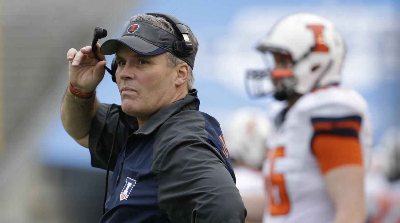 FILE - In this Dec. 26, 2014, file photo, former University of Illinois head coach Tim Beckman watches from the sidelines during an NCAA college football game in Dallas. Former Illinois coach Beckman is working as a volunteer assistant at No. 22 North Car