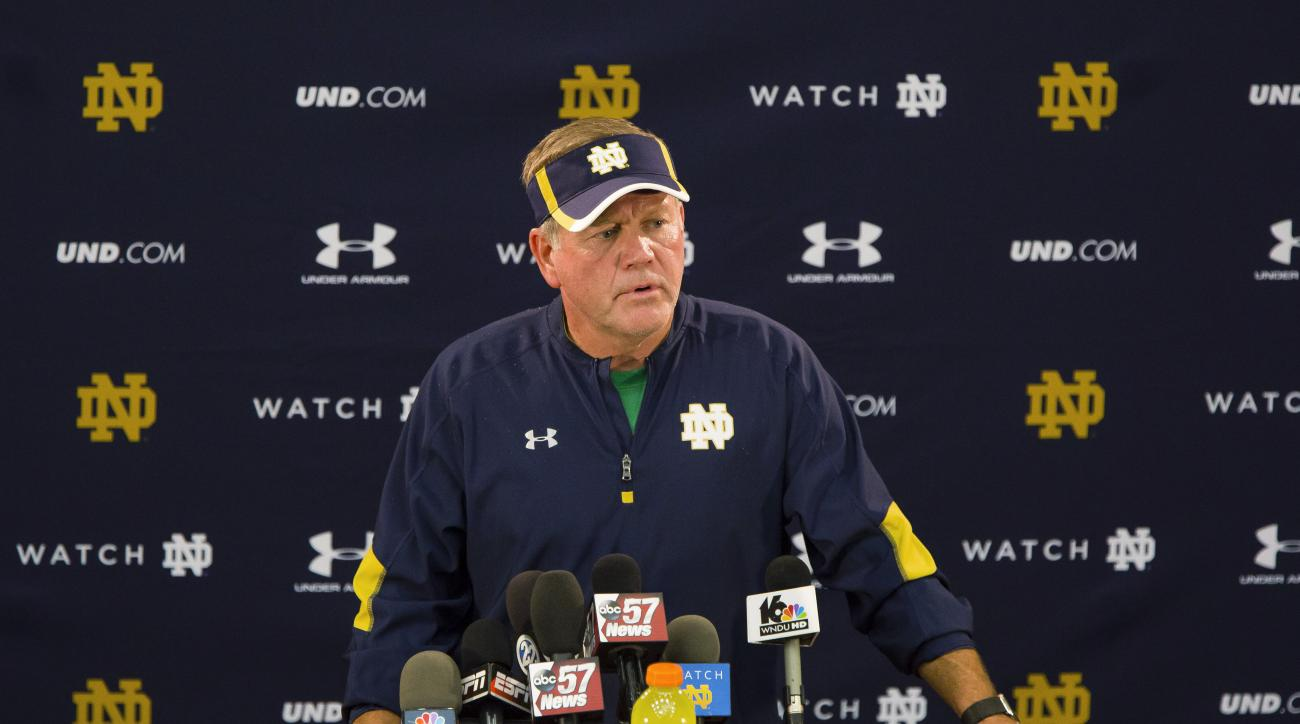 Notre Dame football coach Brian Kelly speaks during a news conference in South Bend, Ind. Wednesday, Aug. 24, 2016. A not guilty plea has been entered on behalf of a Notre Dame cornerback accused of tackling a police officer and punching him during an alt