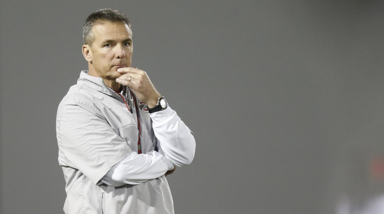FILE - In this March 8, 2016, file photo, Ohio State coach Urban Meyer watches NCAA college football practice in Columbus, Ohio. When Ohio State opened training camp earlier this month, coach Urban Meyer said it was open season for starting jobs. With abo