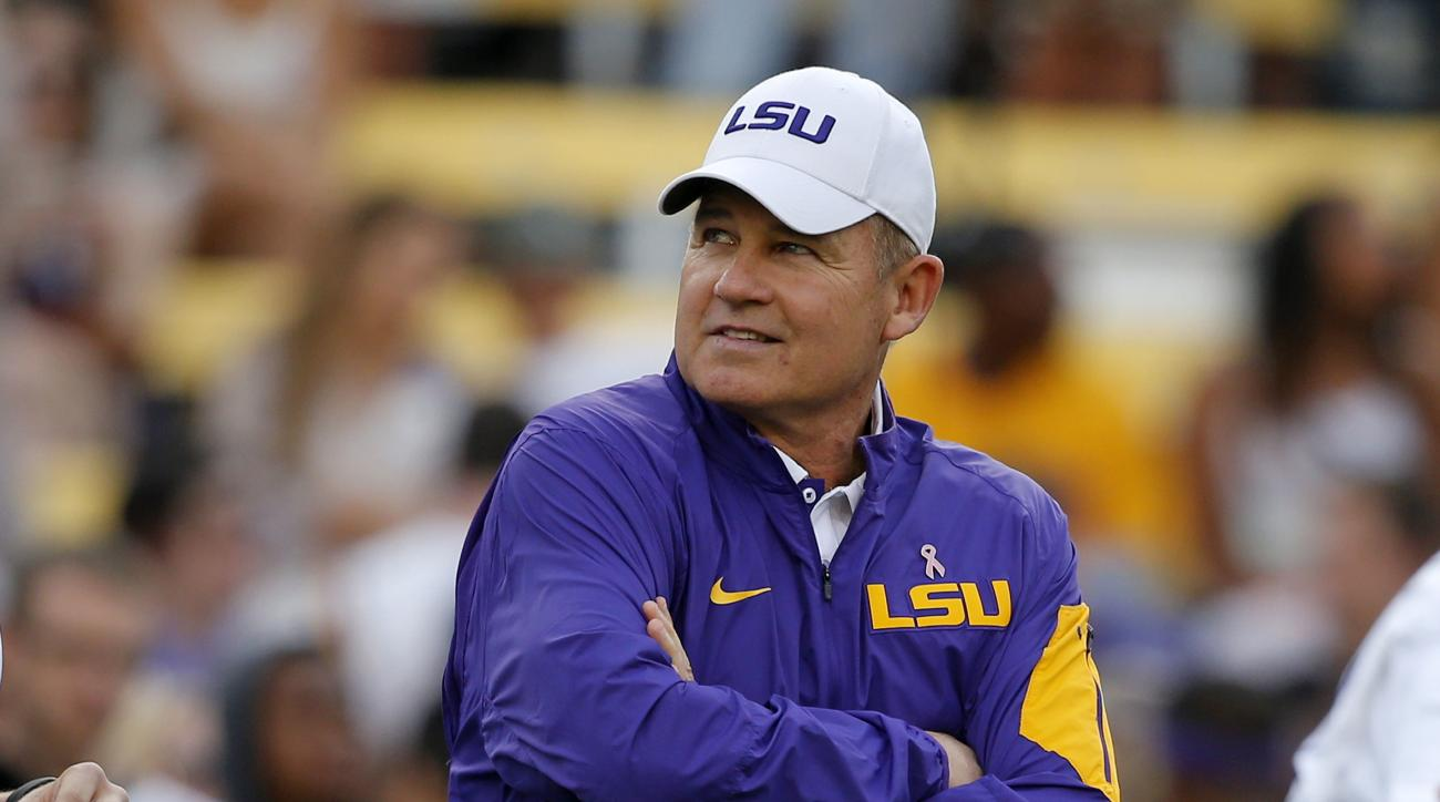 FILE - In this Oct. 17, 2015, file photo, LSU coach Les Miles watches his team warm up before an NCAA college football game against Florida in Baton Rouge, La. That Les Miles could be even considered to be on the dreaded hot seat at LSU entering this seas