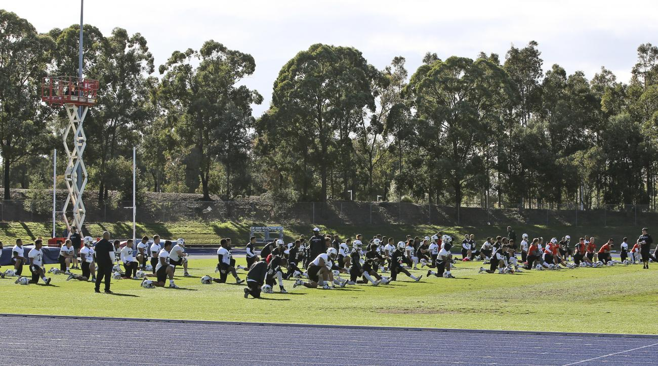 Hawaii Rainbow Warriors stretch during training at a field in Sydney, Australia, Friday, Aug. 26, 2016. The California Golden Bears will play Hawaii's Rainbow Warriors in the first college football game of the 2016 season at the College Football Sydney Cu