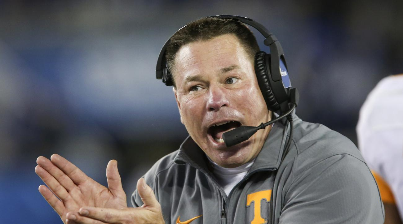 FILE - In this Oct. 31, 2015, file photo, Tennessee head coach Butch Jones applauds his team after they scored during the second half of an NCAA college football game against Kentucky in Lexington, Ky. With less than a week to go before the start of the s