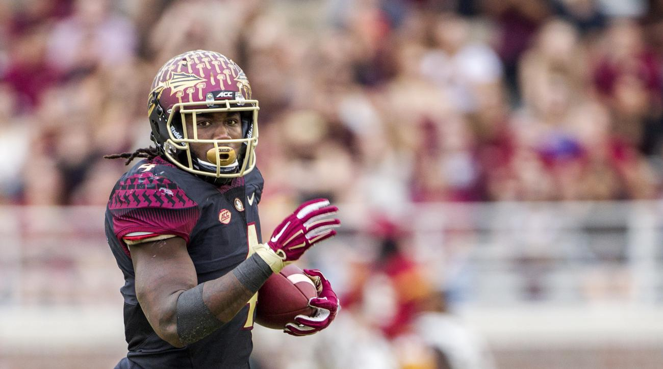 FILE - In this Nov. 21, 2015, file photo, Florida State running back Dalvin Cook runs for a touchdown in the first half of an NCAA college football game in Tallahassee, Fla. Cook knows that everyone is focusing on him this season. The junior though is hop