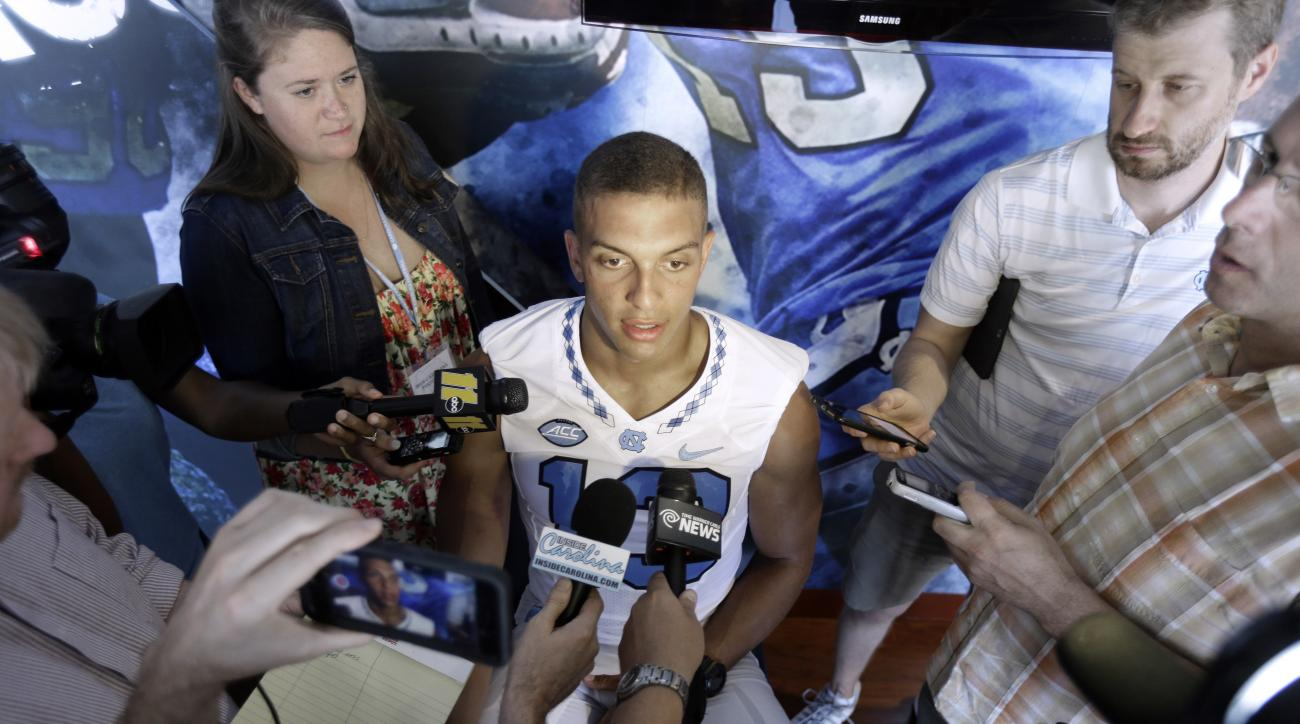 FILE - In this Aug. 6, 2016, file photo, North Carolina wide receiver Mack Hollins speaks to members of the media during the NCAA college football team's media day in Chapel Hill, N.C. No. 22 North Carolina won't have Hollins for the first half of Saturda