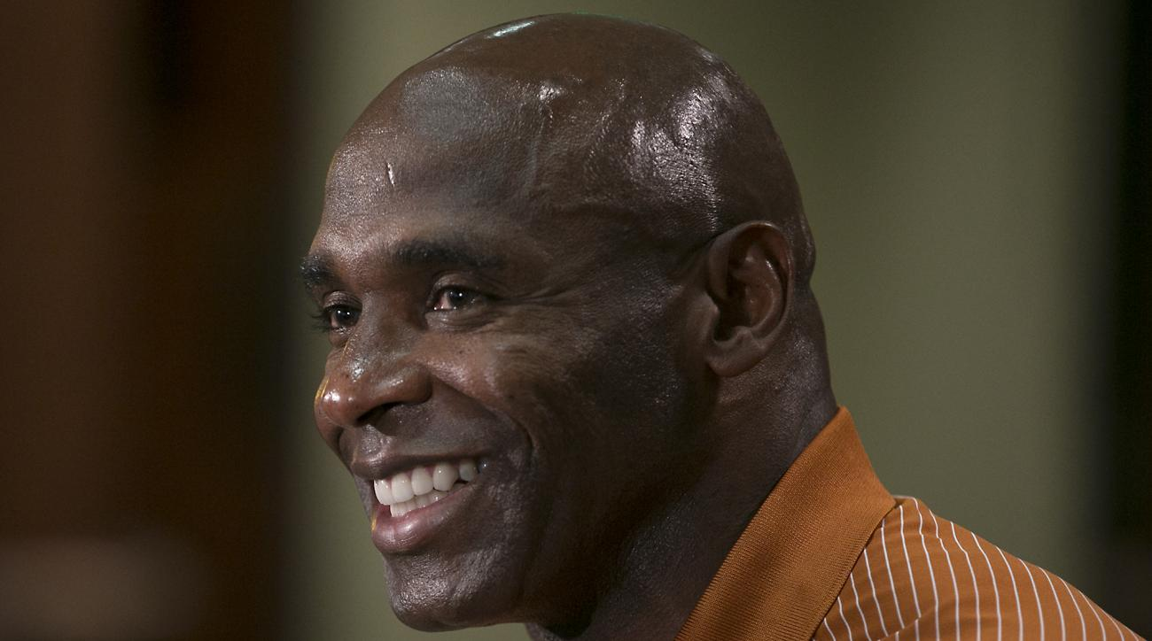 FILE - In this Aug. 5, 2016, file photo, Texas football coach Charlie Strong smiles as he talks about the upcoming season, in Austin, Texas. Texas coach Strong is keeping his big secret until game day. Strong on Monday, Aug. 29, 2016, declined to say will