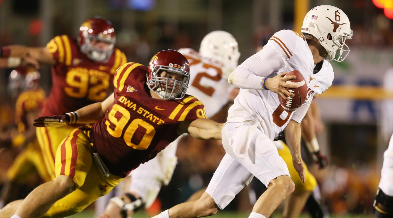 FILE - In this Oct. 3, 2013, photo, Iowa State defensive lineman Mitchell Meyers (90) chases Texas quarterback Case McCoy out of the backfield during an NCAA college football game in Ames, Iowa. Meyers spent a year away from football to battle cancer. Now