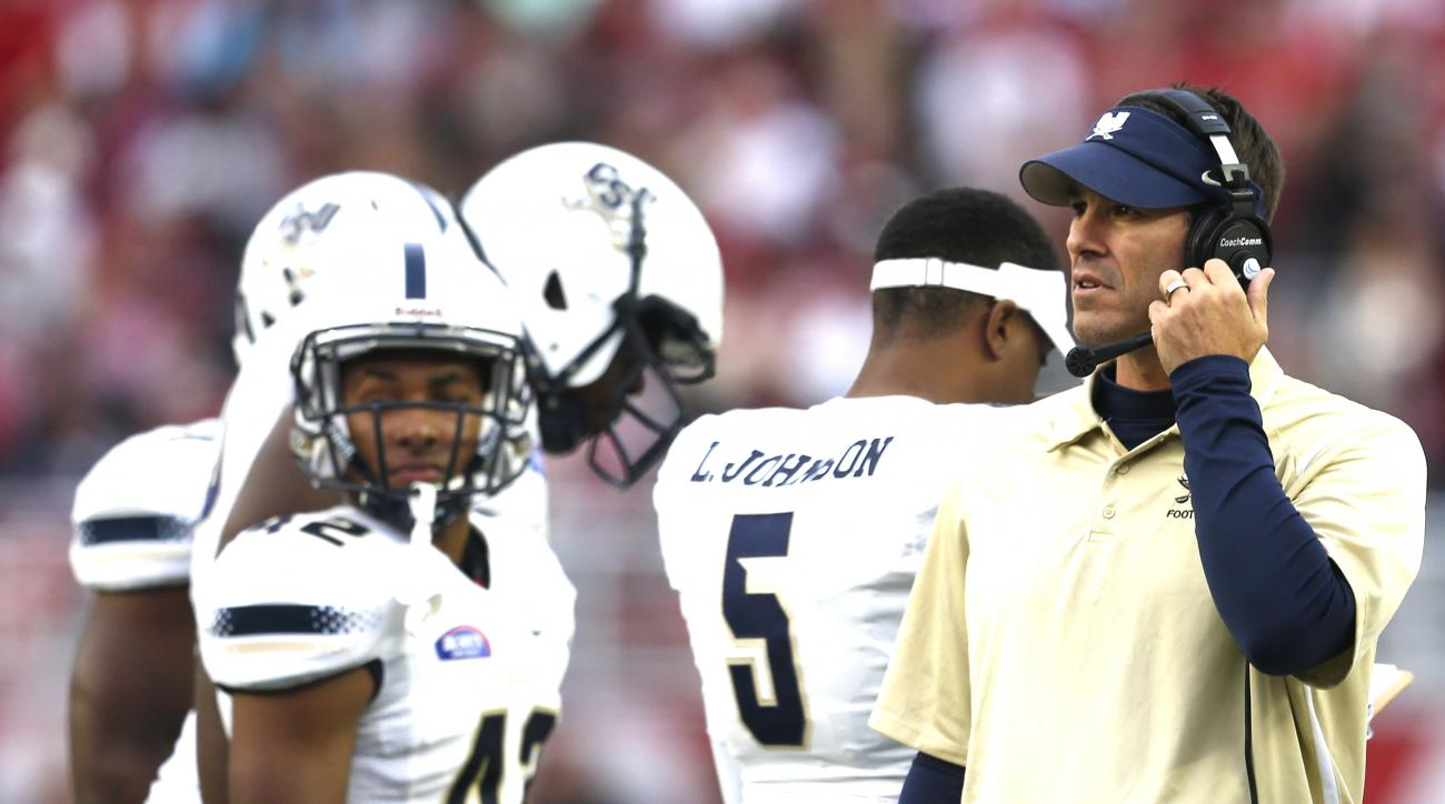 Charleston Southern head coach Jamey Chadwell talks with players during the first half of an NCAA football game against Alabama, Saturday, Nov. 21, 2015, in Tuscaloosa, Ala. (AP Photo/Butch Dill)