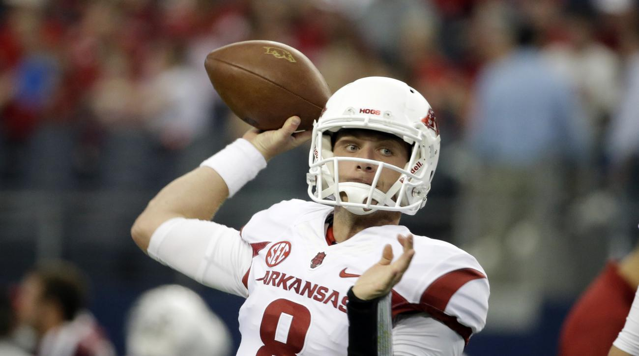 FILE - In this Sept. 27, 2014, file photo, Arkansas quarterback Austin Allen passes during warm ups before an NCAA college football game against Texas A&M, in Arlington, Texas. Austin Allen has looked the part of starting quarterback throughout the presea