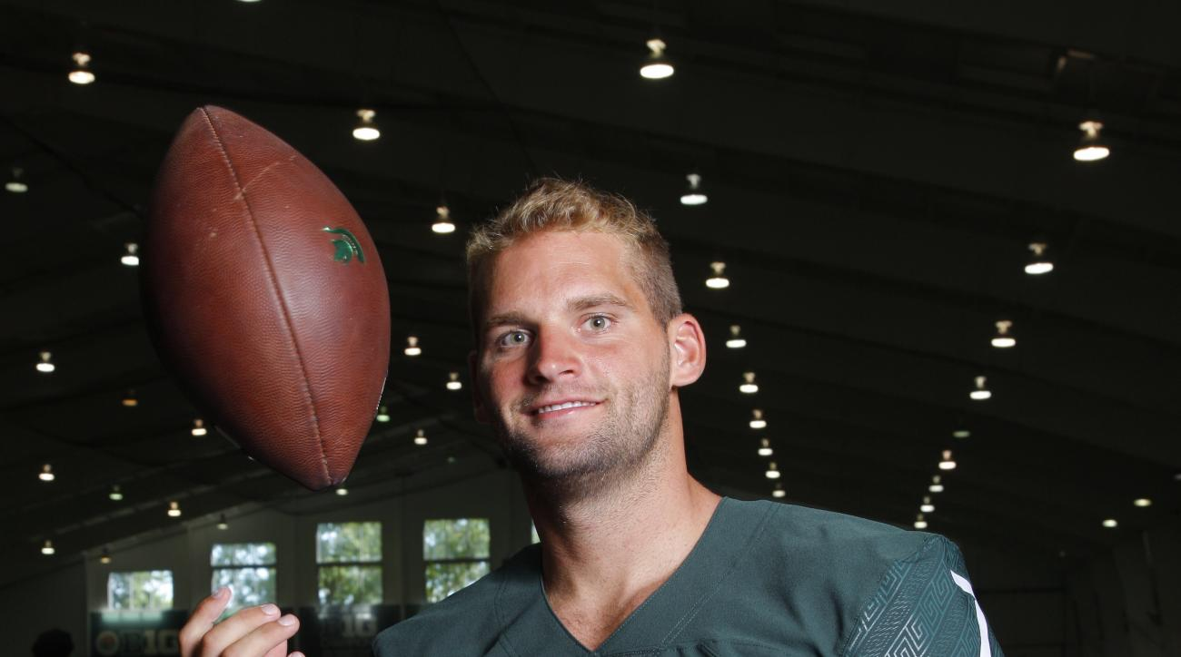 FILE - In this Aug. 8, 2016, file photo, Michigan State quarterback Tyler O'Connor is shown during the team's NCAA college football media day, in East Lansing, Mich. O'Connor takes over as Michigan State's new starting quarterback, and he should have a ch