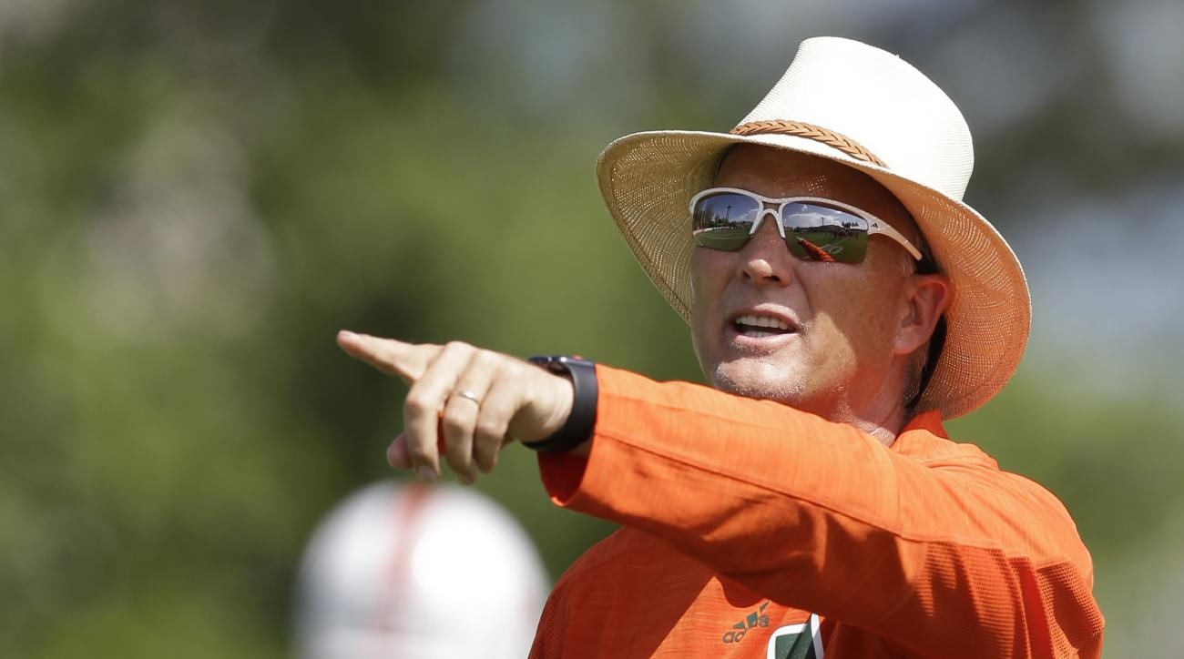 FILE - In this Aug. 4, 2016, file photo, Miami coach Mark Richt shouts instructions during the NCAA college football team's practice, in Coral Gables, Fla. Richts team is looking at starting three true freshmen at linebacker in Saturdays season-opener aga