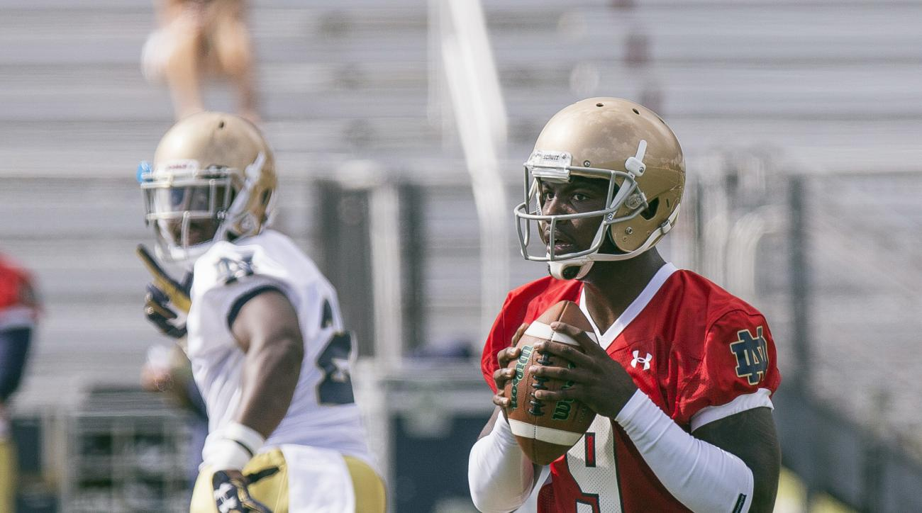 FILE - In this Aug. 6, 2016, file photo, Notre Dame quarterback Malik Zaire sets up to throw a pass during football practice at Culver Military Academy in Culver, Ind. Head coach Brian Kelly says he still doesn't know if Zaire or quarterback DeShone Kizer