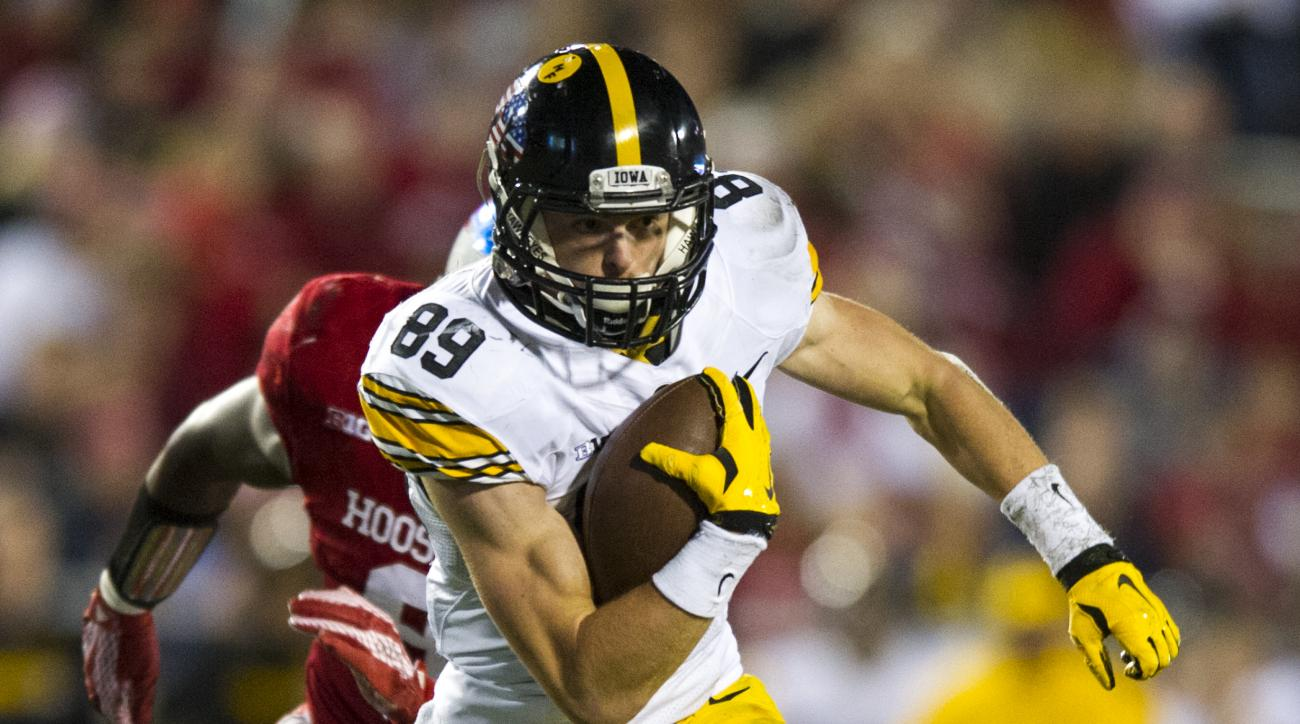 FILE - In this Saturday, Nov. 7, 2015 file photo, Iowa wide receiver Matt VandeBerg (89) rushes the ball into the Indiana defense during the second half of an NCAA college football game in Bloomington, Ind. The 17th-ranked Hawkeyes will be led by one of t