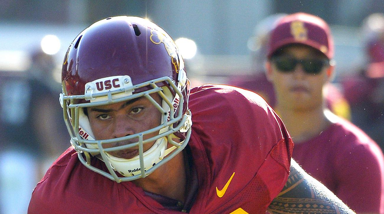 Southern California's Osa Masina works out during NCAA college football practice in Los Angeles on Tuesday, Aug. 30, 2016. Masina is being investigated on suspicion of sexual assault in Utah. Police documents released Tuesday show authorities are looking