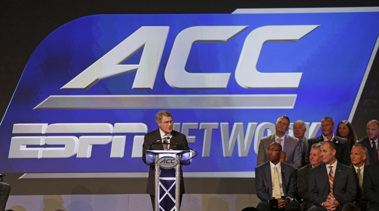 FILE - In this July 21, 2016, file photo, ACC Commissioner John Swofford, center, announces an ACC/ESPN Network during a news conference at the Atlantic Coast Conference Football Kickoff in Charlotte, N.C. The Atlantic Coast Conferences dedicated televisi