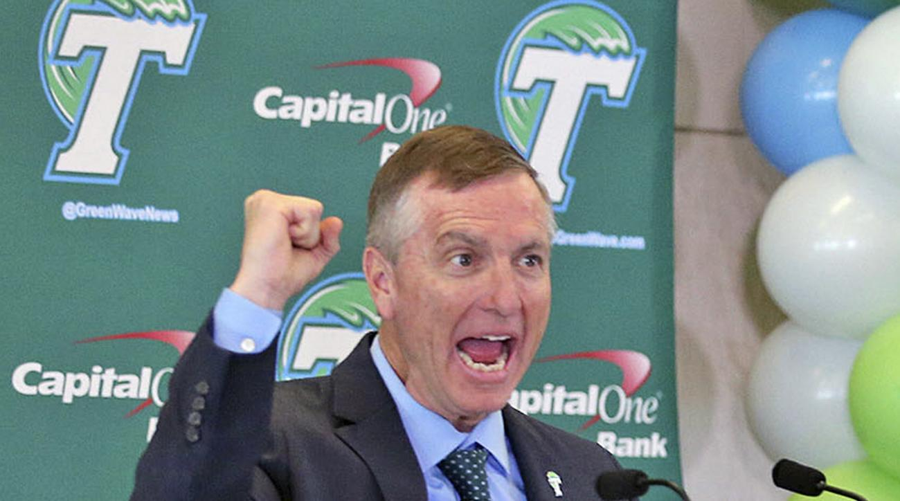 FILE - In this Dec. 15, 2015, file photo, Willie Fritz cheers as he is formally introduced as Tulance NCAA college football head football coach during a news conference in New Orleans.  Fritz debuts for Tulane against Wake Forest on Thursday night.  (Mich