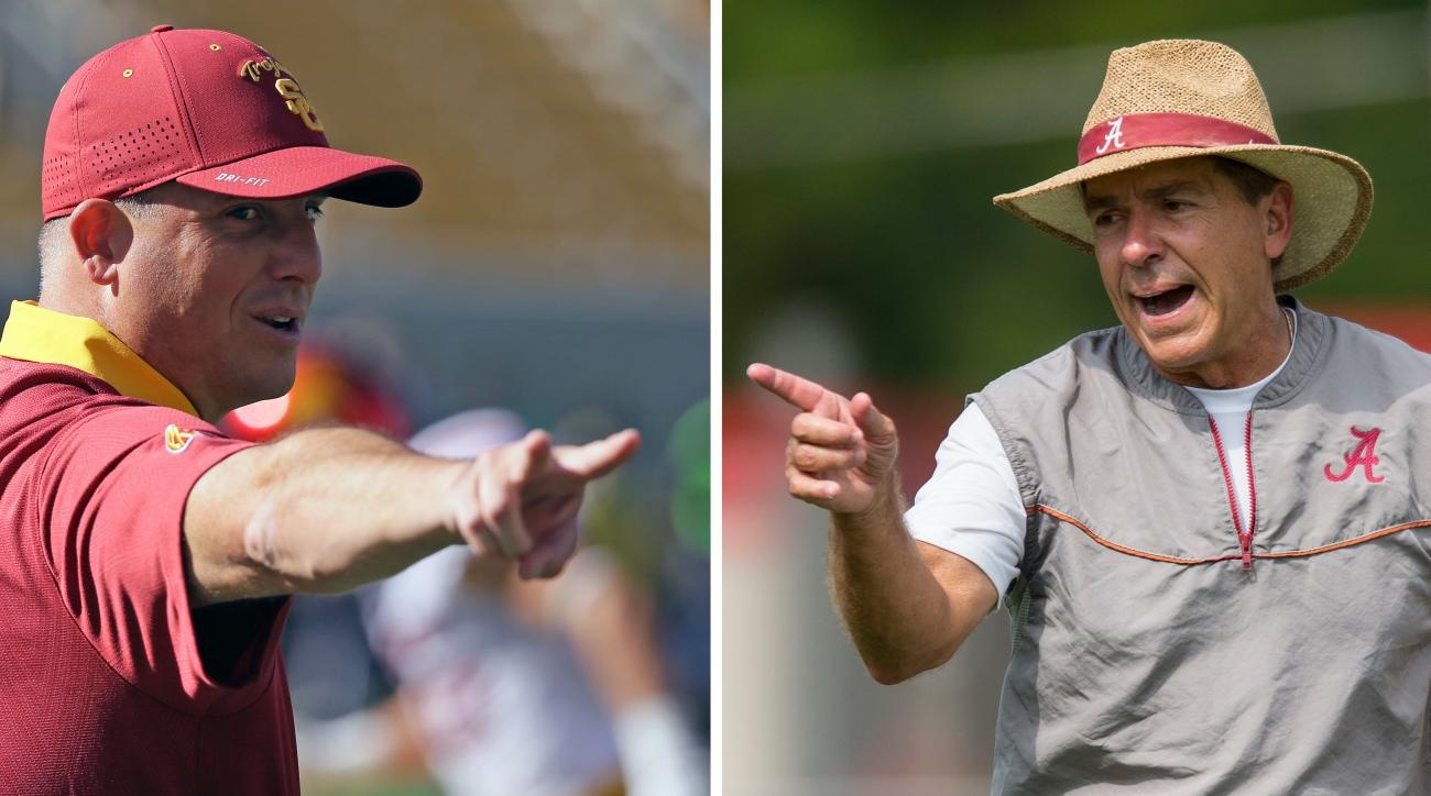 FILE - At left, in an Oct. 31, 2015, file photo, Southern California head coach Clay Helton gestures before the start of their NCAA college football game against California, in Berkeley. At right, in an Aug. 9, 2016, file photo, Alabama coach Nick Saban g