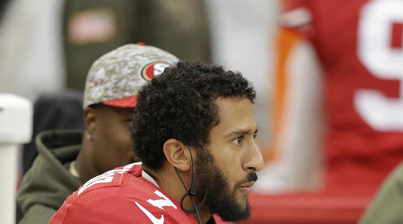 FILE--In this Nov. 8, 2015, file photo, San Francisco 49ers quarterback Colin Kaepernick sits on the sideline during the second half of an NFL football game against the Atlanta Falcons in Santa Clara, Calif. A northern Nevada airport is getting an earful
