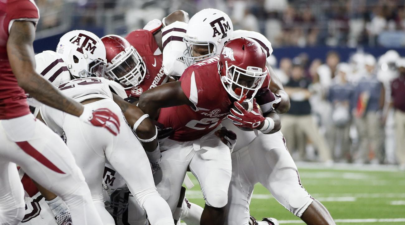 FILe - In this Sept. 26, 2015, file photo, Arkansas running back Rawleigh Williams fights his way into the end zone for a touchdown against Texas A&M during the second half of an NCAA college football game, in Arlington, Texas. The last time Arkansas runn