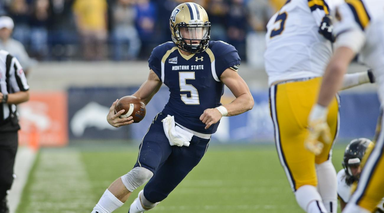 FILE - In this Saturday, Oct. 24, 2015 photo, Montana State quarterback Dakota Prukop runs the ball against East Tennessee State during the first half of an NCAA college football game in Bozeman, Mont. Oregon has a new quarterback this season in Dakota Pr