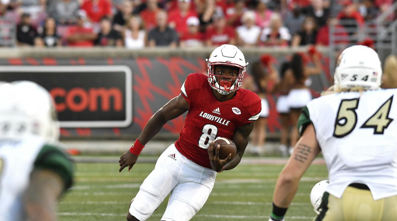 Louisville quarterback Lamar Jackson (8) carries against Charlotte during the first quarter of an NCAA college football game, Thursday, Sept. 1, 2016, in Louisville, Ky. (AP Photo/Timothy D. Easley)