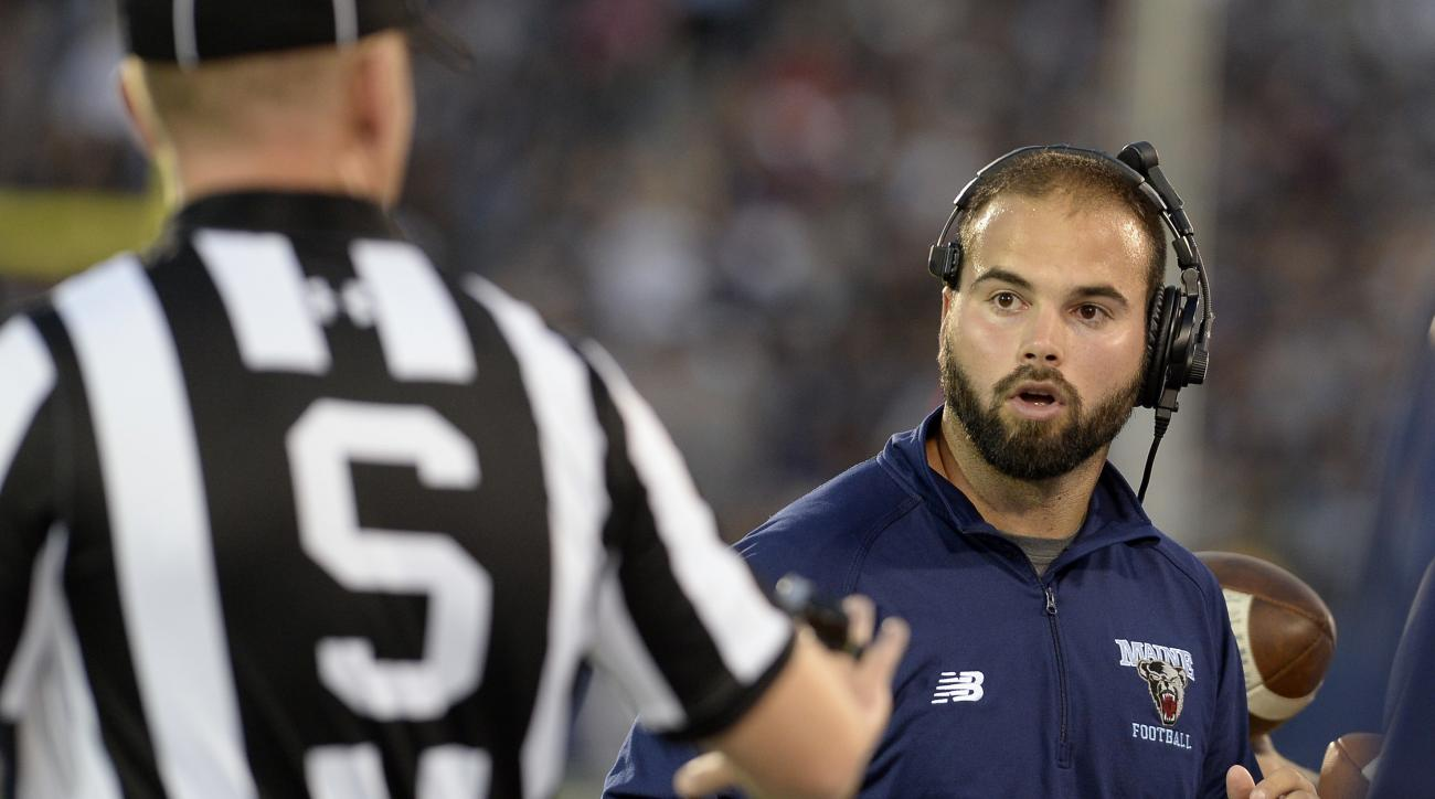 CORRECTS TO JOE HARASYMIAK NOT JACK COSGROVE - Maine head coach Joe Harasymiak, right, looks at an official during the first half of an NCAA college football game against Connecticut , Thursday, Sept. 1, 2016, in East Hartford, Conn. (AP Photo/Jessica Hil