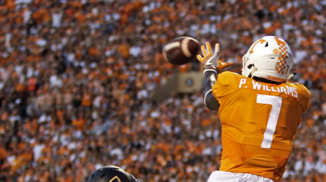 Tennessee wide receiver Preston Williams (7) leaps for a pass as he's defended by Appalachian State defensive back Clifton Duck (22) during the first half of an NCAA college football game Thursday, Sept. 1, 2016, in Knoxville, Tenn. (AP Photo/Wade Payne)