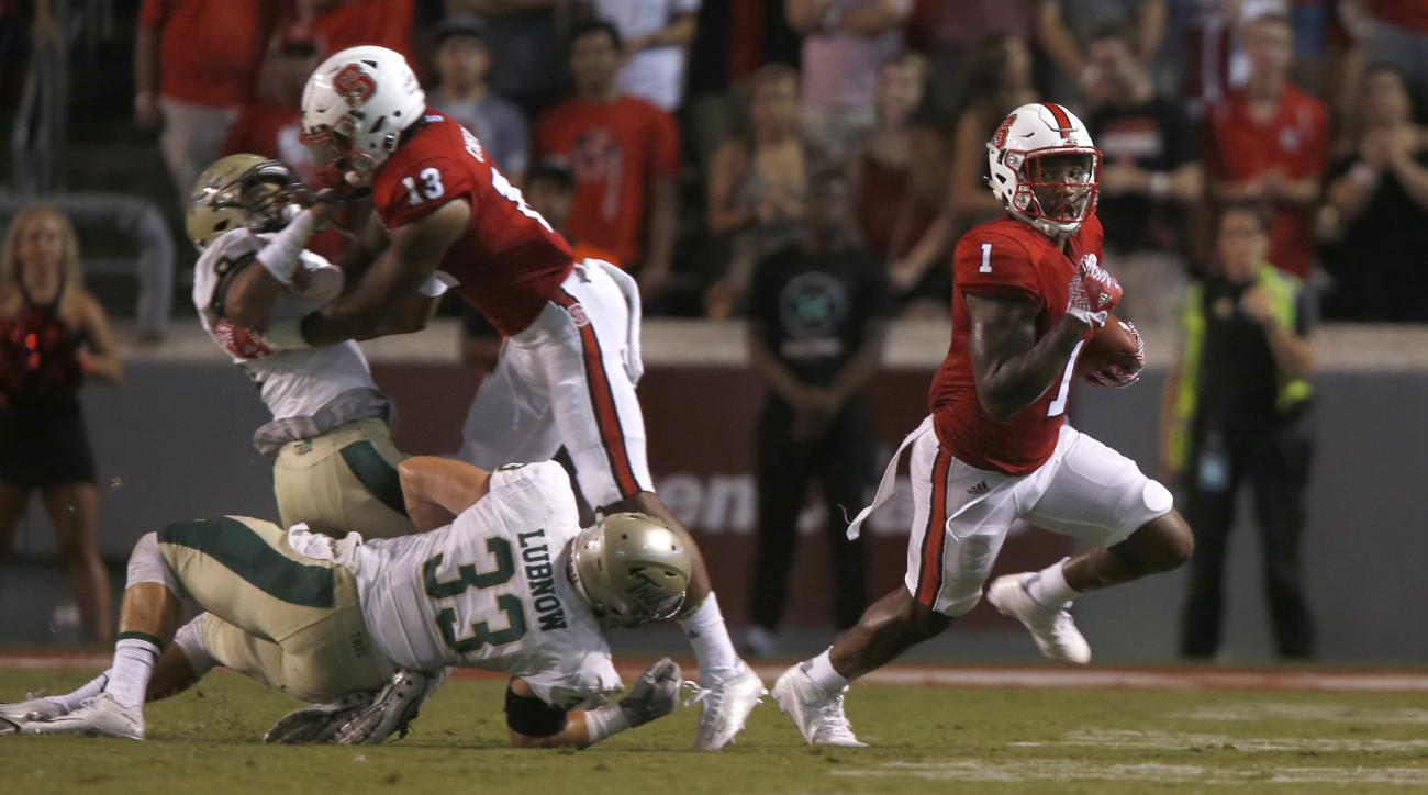 North Carolina State's Jaylen Samuels (1) breaks free for a gain during the first half of an NCAA college football game against William & Mary, Thursday, Sept. 1, 2016 at Carter-Finley Stadium in Raleigh, N.C. (Ethan Hyman/The News & Observer via AP)