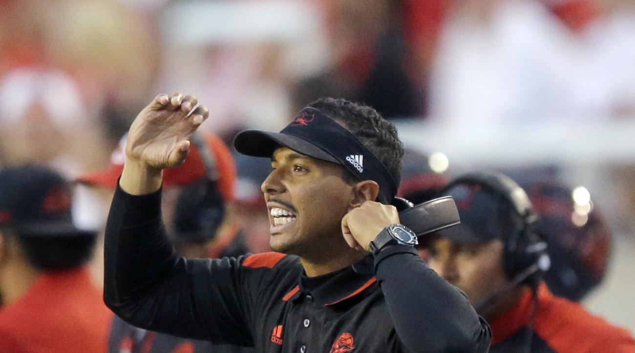 Southern Utah head coach Demario Warren shouts to his team in the first half during an NCAA college football game against Utah Thursday, Sept. 1, 2016, in Salt Lake City. (AP Photo/Rick Bowmer)