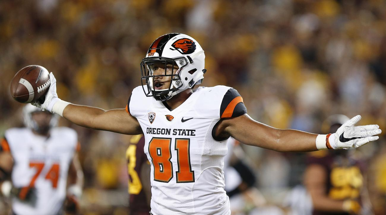 Oregon State player Noah Togiai (81) celebrates after a touchdown against Minnesota during an NCAA college football game Thursday, Sept. 1, 2016, in Minneapolis. (AP Photo/Stacy Bengs)