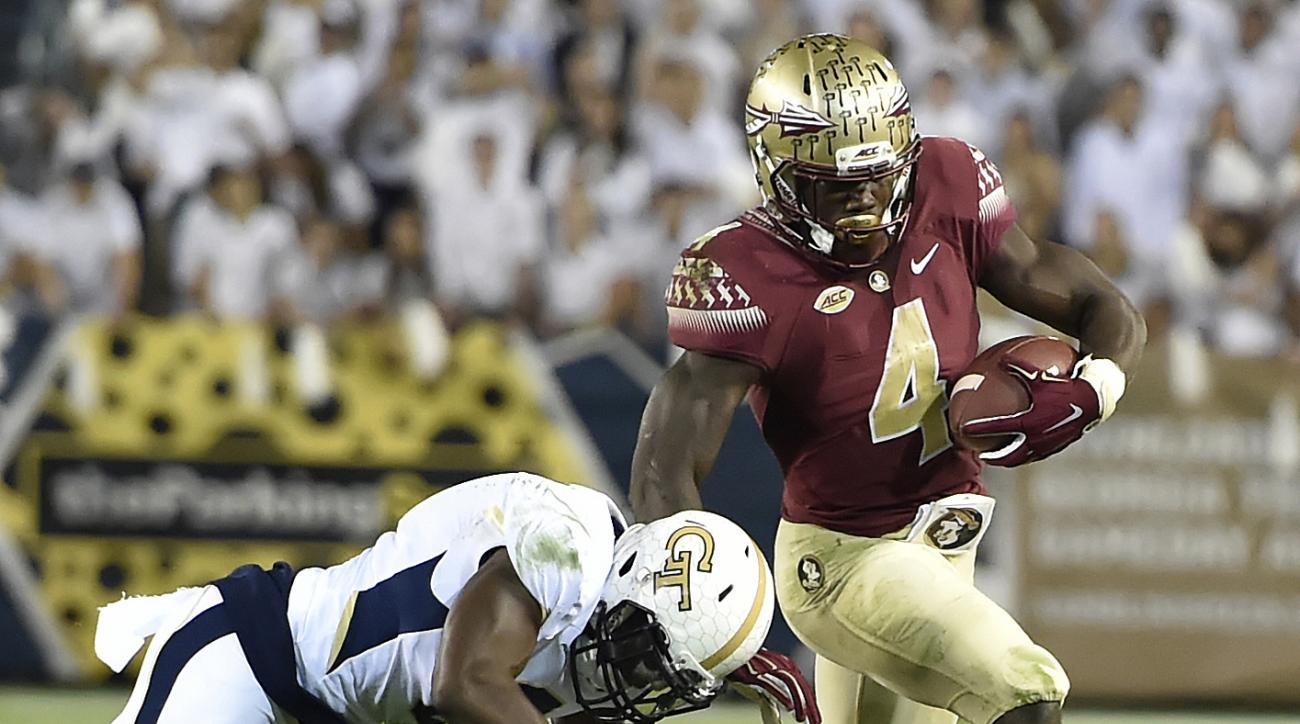 FILE - In this Oct. 24, 2015, file photo, Florida State running back Dalvin Cook (4) runs against Georgia Tech defensive back Step Durham (8) during an NCAA college football game in Atlanta. Florida State faces Mississippi on Monday night, Sept. 5. Cook i