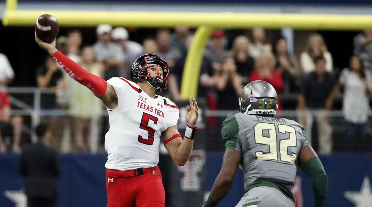 FILE - In this Oct. 3, 2015, file photo, Texas Tech quarterback Patrick Mahomes (5) throws a long touchdown pass to wide receiver Zach Austin under pressure from Baylor defensive end Jamal Palmer (92) in the first half of an NCAA college football game, in