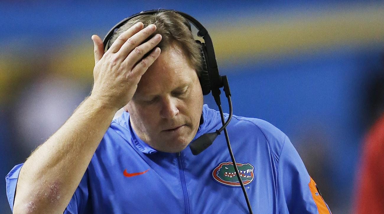 FILE - In this Dec. 5, 2015, file photo, Florida head coach Jim McElwain walks down the sidelines during the first half of the Southeastern Conference championship NCAA college football game against Alabama, in Atlanta. And after the way Florida ended las