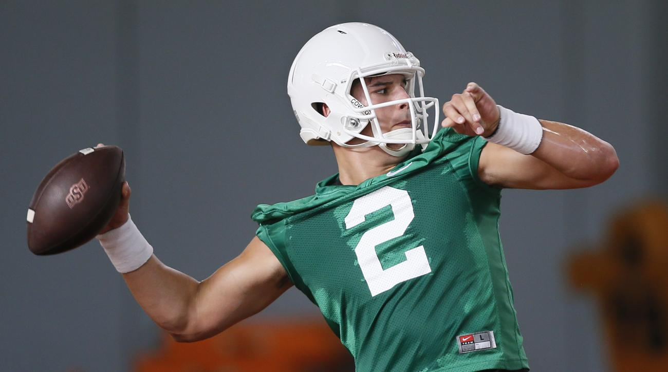 FILE - In this Tuesday, Aug. 2, 2016 file photo, Oklahoma State quarterback Mason Rudolph throw during an NCAA college football practice in Stillwater, Okla. Oklahoma State's strong performance last season and the return of 18 starters have earned the Cow
