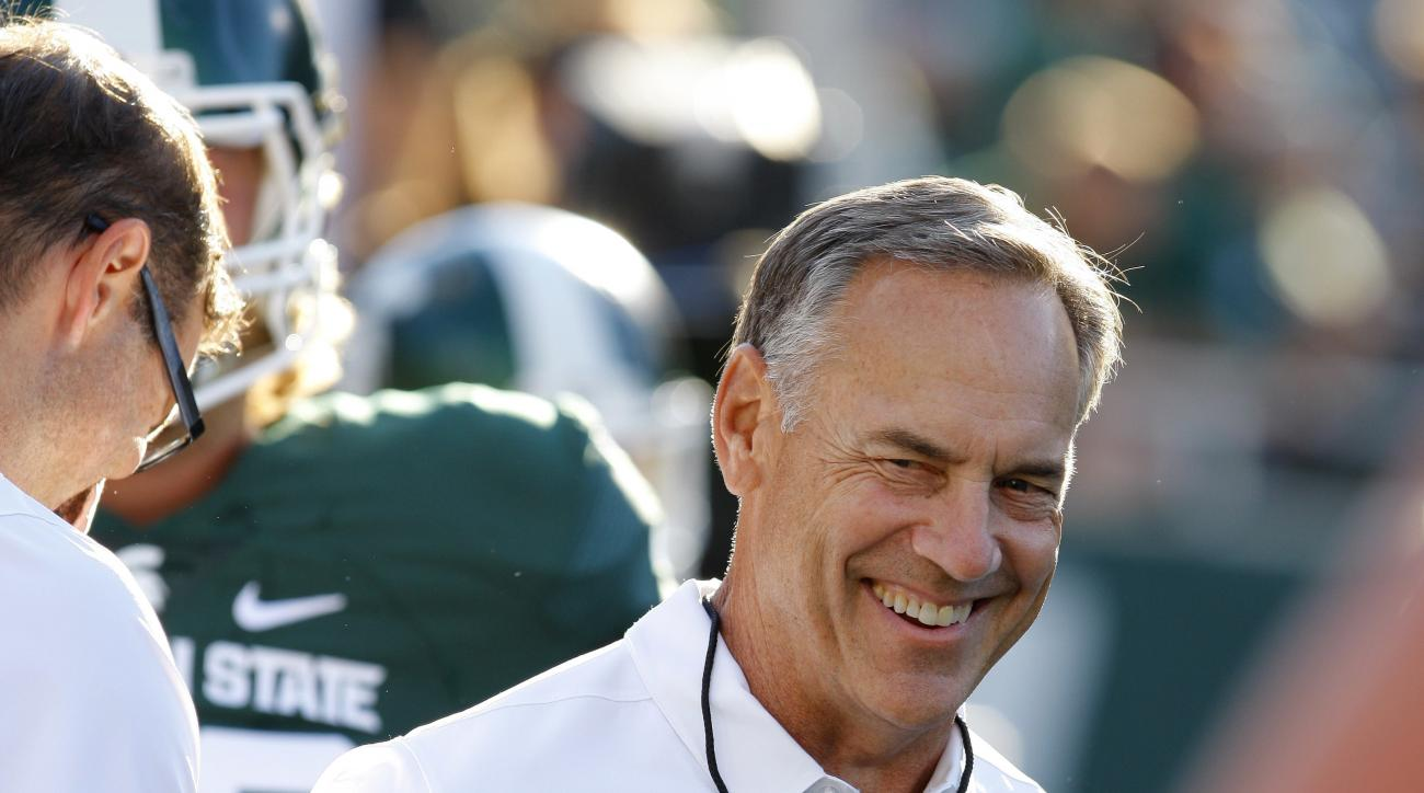 Michigan State head coach Mark Dantonio, right, and offensive line coach Mark Staten laugh before the team's NCAA college football game against Furman, Friday, Sept. 2, 2016, in East Lansing, Mich. (AP Photo/Al Goldis)