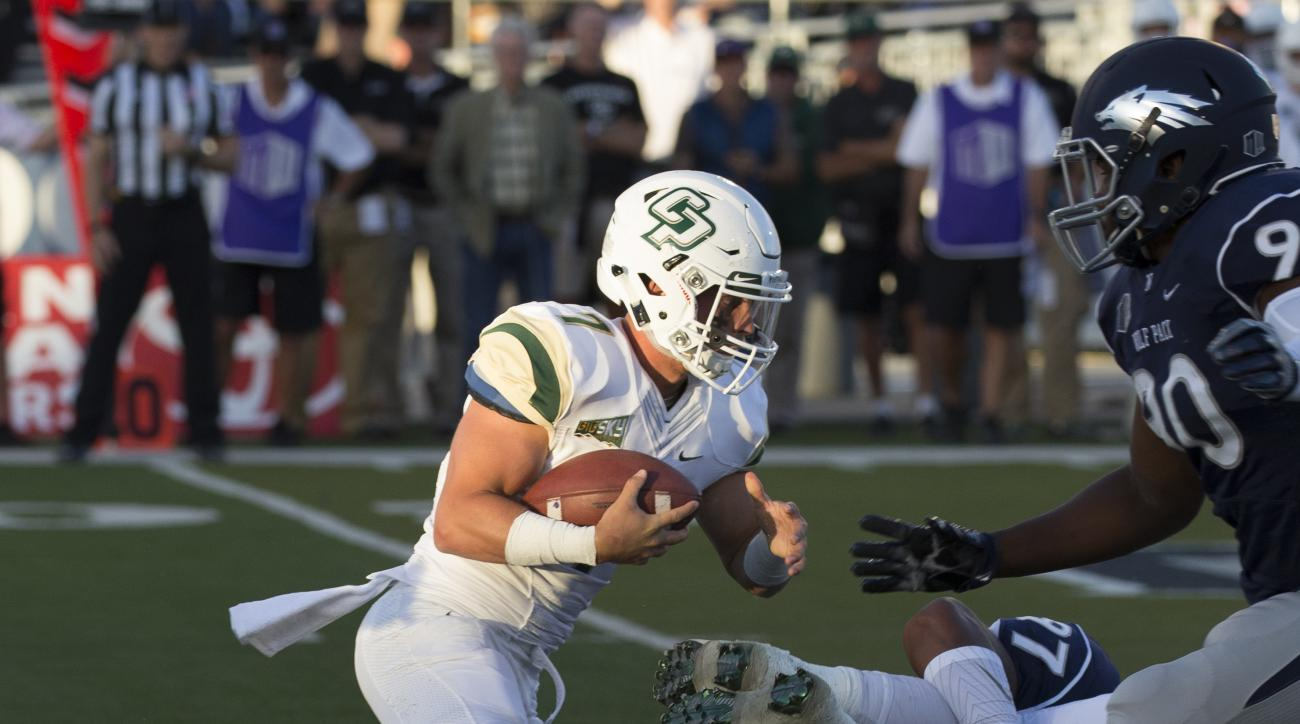 Cal Poly quarterback Dano Graves runs against Nevada during the first quarter of an NCAA college football game Friday, Sept. 2, 2016, in Reno, Nev. (AP Photo/Tom R. Smedes)
