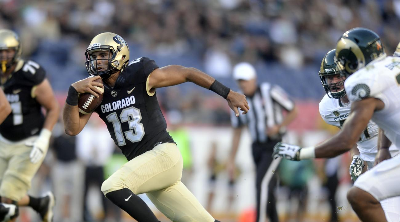 Colorado quarterback Sefo Liufau carries against Colorado State during the first half of an NCAA college football game Friday, Sept. 2, 2016, in Boulder, Colo. (Jeremy Papasso/Daily Camera via AP)