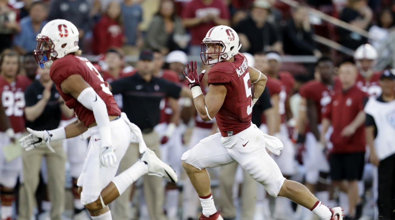 Stanford running back Christian McCaffrey, right, runs for a 35-yard touchdown against Kansas State during the first half of an NCAA college football game Friday, Sept. 2, 2016, in Stanford, Calif. (AP Photo/Marcio Jose Sanchez)