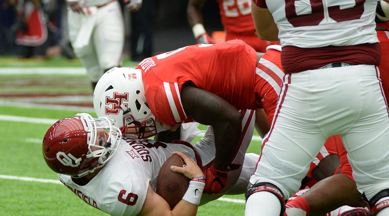 Oklahoma quarterback Baker Mayfield (6) is tackled by Houston linebacker Matthew Adams (9) in the first half of an NCAA football game Saturday, Sept. 3, 2016, in Houston. (AP Photo/George Bridges)