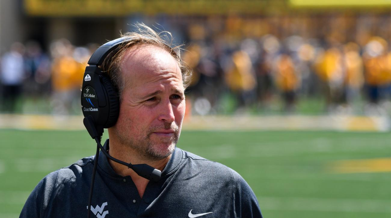 West Virginia head coach Dana Holgorsen waches the first half of an NCAA college football game against Missouri in Morgantown, W. Va., Saturday Sept. 3, 2016. (AP Photo/Tyler Evert)