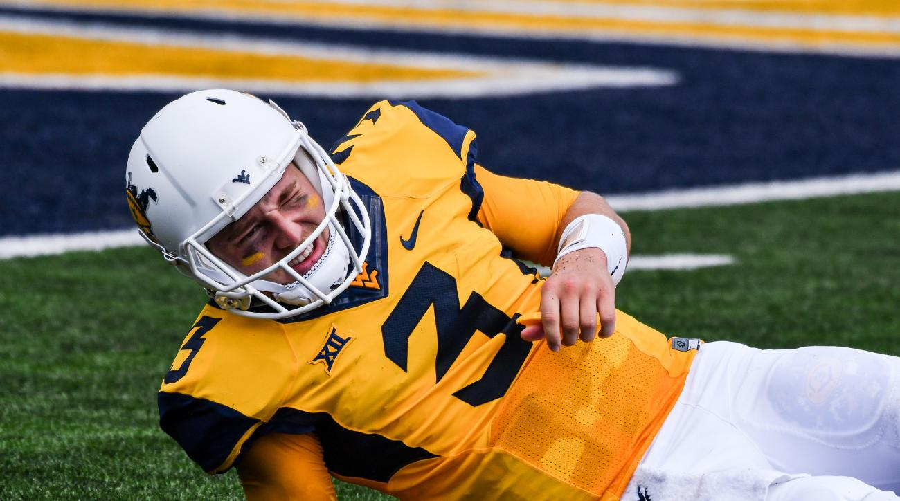 West Virginia's Skylar Howard (3) goes down with an injury during the first half of an NCAA college football game against Missouri in Morgantown, W. Va., Saturday Sept. 3, 2016. (AP Photo/Tyler Evert)