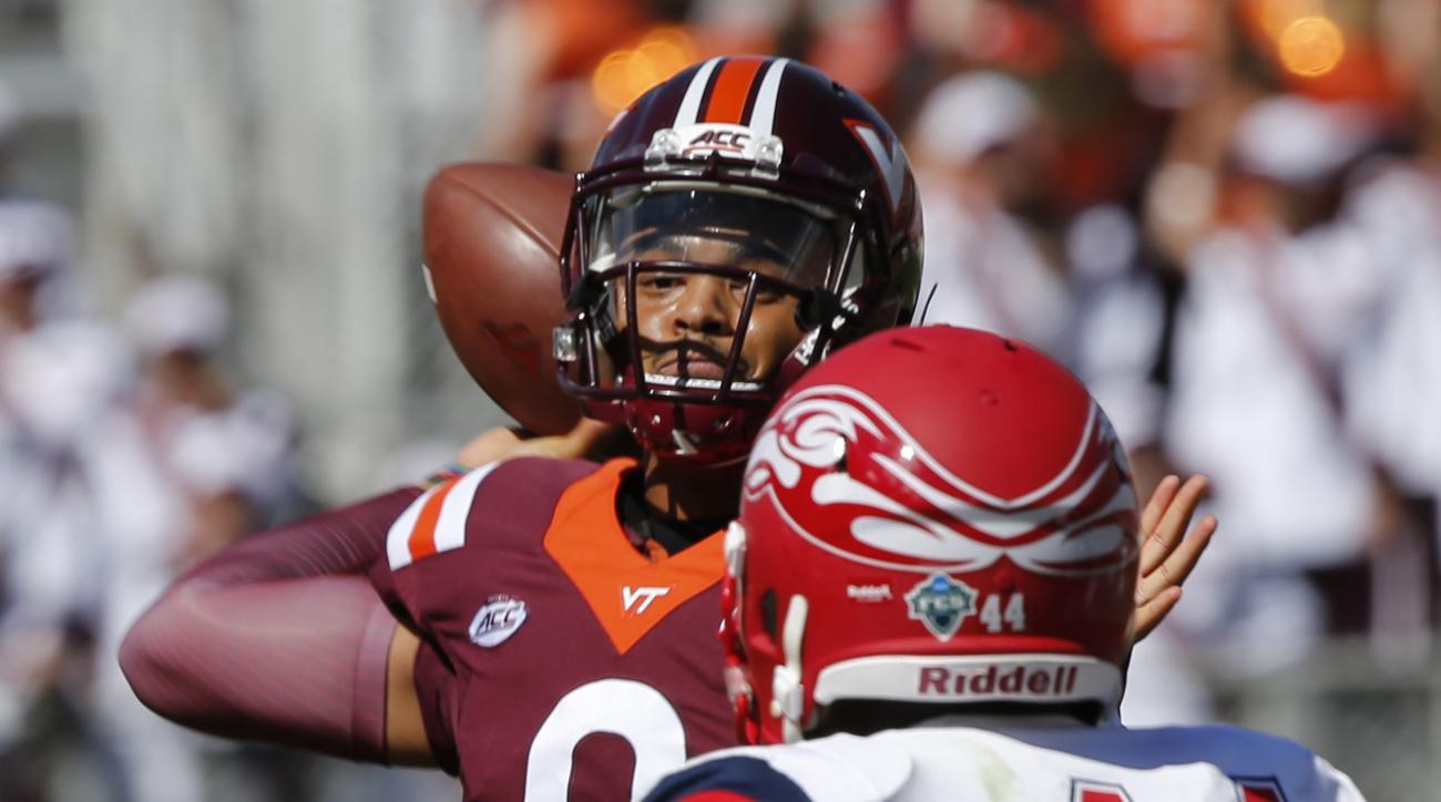 Virginia Tech quarterback Brenden Motley (9) makes a toss in front of Liberty defensive end Dia'Vante Brown (44) during the second half of an NCAA college football game in Blacksburg, Va., Saturday, Sept. 3, 2016. Virginia Tech defeated Liberty 36-13. (AP