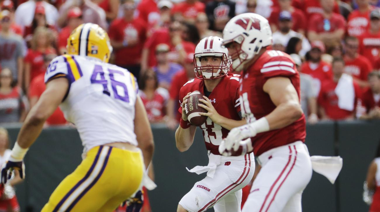 Wisconsin quarterback Bart Houston scrambles during the first half of an NCAA college football game against LSU Saturday, Sept. 3, 2016, in Green Bay, Wis. (AP Photo/Morry Gash)