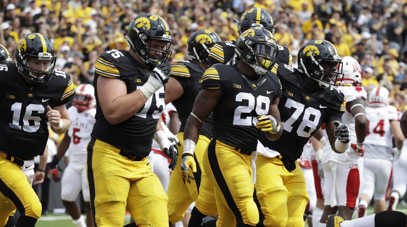 Iowa running back LeShun Daniels Jr. (29) celebrates with teammates after scoring on a 43-yard touchdown run in the first half of an NCAA college football game against Miami of Ohio, Saturday, Sept. 3, 2016, in Iowa City, Iowa. (AP Photo/Charlie Neibergal