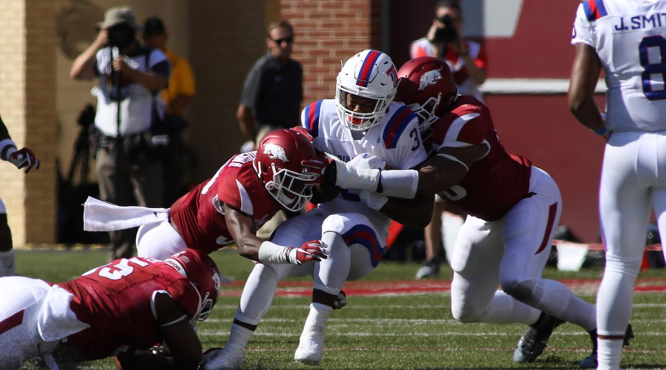 Louisiana Tech's Jarred Craft (3) gets caught by the Arkansas defense during the first half of an NCAA football game Saturday, Sept. 3, 2016 in Fayetteville, Ark. (AP Photo/Samantha Baker)
