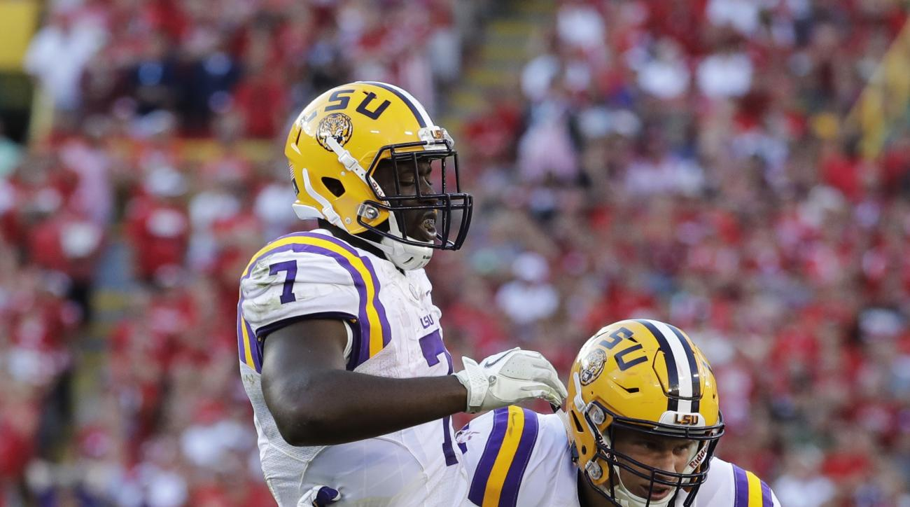 LSU's Leonard Fournette (7) is helped off the field by teammate Foster Moreau after being injured on a play during the second half of an NCAA college football game against Wisconsin Saturday, Sept. 3, 2016, in Green Bay, Wis. Wisconsin won 16-14. (AP Phot