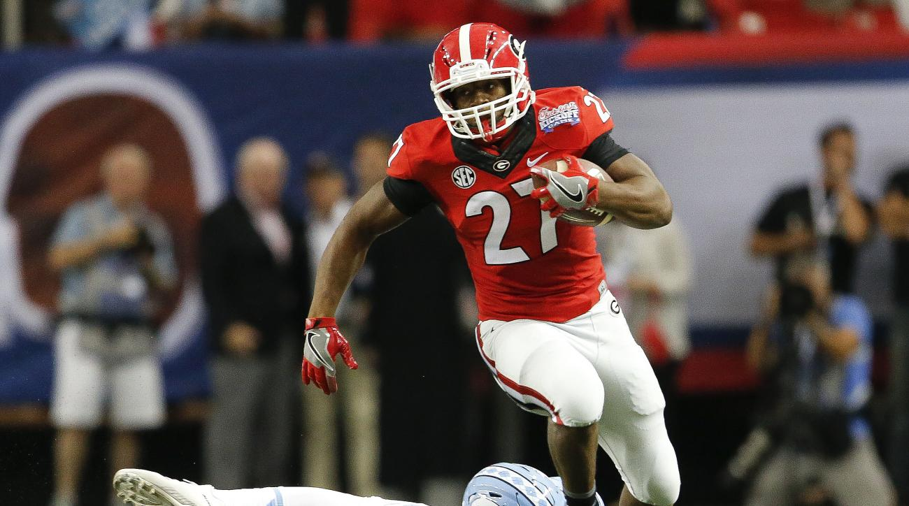 Georgia running back Nick Chubb (27) breaks away from North Carolina linebacker Cayson Collins (23) in the first half of an NCAA college football game in Atlanta, Saturday, Sept. 3, 2016. (AP Photo/John Bazemore)